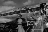 1954 - Jimmy Stewart and his wife Gloria arrive in Miami for world premiere of The Glenn Miller Story at 3 Miami theatres
