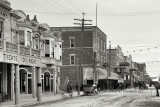 1908 - looking east on 12th Street  (now Flagler Street) at Avenue D (now Miami Avenue) in downtown Miami - left half of image