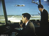 1953 - FAA Air Traffic Controller Don Innes and another gent at MIA's Tower #8 with Eastern Constellation in the background
