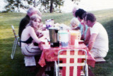Early 1970's - John M. Boyd (left, brown jacket) having dinner outside at the Henderson's on Upper Rideau Lake, Ontario, Canada