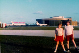 1976 - Dan and Denise Griffis at Miami International Airport with the National Airlines Maintenance Base in the background