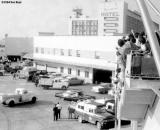 1964 - the Beatles departing Miami International Airport in the black limo, lower center