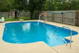2006 - Nephew David adding chlorine to his backyard pool