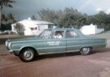 1968 - Officer Fred E. Daughtry Sr. in his Biscayne Park Police Department patrol car