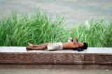 Napping on the Sisovath Quay, the riverfront promenade.