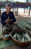 Wrapping the palm sugar for sale.