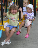 ella and audrey on swings