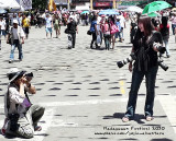 Photo was taken during my live TV coverage of the festival parade. I was holding two cameras while my microphone is in my back pocket. The third camera is from my friend for pictorial purposes. :-)