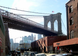 The Brooklyn Bridge - seen from Water St. looking northwest - the DUMBO section of Brooklyn. Manhattan is in the background.