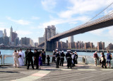 Two wedding parties at the Fulton Ferry Landing Pier in Brooklyn - foreign soldiers are in one wedding party.
