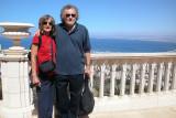 Judy and Richard in the Baha'i Gardens in Haifa. Haifa and the Mediterranean Sea are in the background.