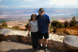 Judy and Richard in the Neftali Mountains overlooking the Hula Valley with the Golan Heights across the Valley in the background