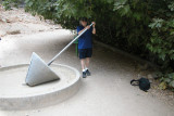 Banias: Richard using a device (by walking in a circle) to make letters, numbers and symbols in the sand.