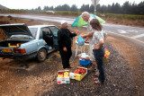 Moshe purchasing apples and Judy purchasing home-made jelly from a Druze Arab on the side of the road in the Golan Heights