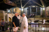 Nazareth: The Basilica of the Annunciation: Priest blessing people as they leave the lower church where the grotto is located.