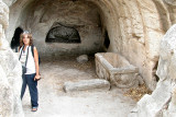 Bet She'arim: Judy in the entrance to the burial Cave of the Lone Sarcophagus, with a courtyard - in the necropolis.