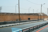 A wall separating Israel from the West Bank - seen while driving south of Jersualem toward Masada.