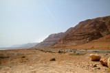 Road to Masada and the Dead Sea in the Judean Desert with beautiful cliff formations. The Dead Sea is to the left.