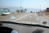 Driving south through a military checkpoint on our way to Masada. The West Bank is nearby.