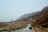 Driving south to Masada through the Judean Desert. The Dead Sea is in the background.