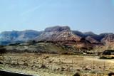This mountain/cliff is Masada. Masada is near the southwestern coast of the Dead Sea, in the Judean Desert.