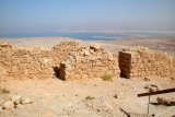 Top of Masada: Part of the wall surrounding Masada with the Dead Sea and mountains in Jordan in the background.