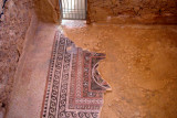 Floor mosaic in King Herod's Western Palace (30 b.c.e.): Mosaics of pomegranates, fig leaves & geometrical pattern of circles.