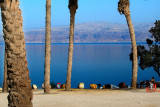 The public beach at the Dead Sea in Ein Gedi. Mountains in Jordan are in the background.