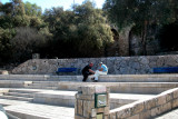 Two men playing chess close to the Mediterranean Sea - in Jaffa.  Part of Jaffa's old city wall is in the background.