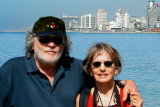Judy and Richard on the promenade in Jaffa - Tel Aviv's skyline and the Meditteranean Sea are in the backgorund.