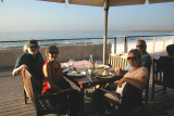 We were having dinner on the promenade next to the beach on the Mediterranean Sea in Tel Aviv.