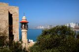 Minaret of the Al-Bahr Mosque in Jaffa - Mediterranean Sea and skyline of Tel Aviv are in the background.