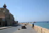 Fisherman along the Mediterranean Sea in Jaffa. The entrance to the Jaffa port is in the background.