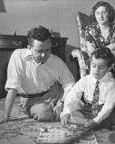 Richard and his father Paul play a game while Hilda (Richard's mother) watches (1948)