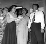 Rosie (Richard's aunt) reading at 45th anniversary party for grandma Anna and grandpa Louis (mother's side) (1952)