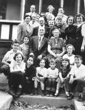 Family party (mother's side) for cousin Phyllis' (dark dress) 16th birthday. Richard is on the left - 2nd row. (1954)