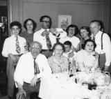 Passover seder at grandparents' (Gussie & Charles) apartment  in the Bronx. Richard is behind grandma Gussie. (1949)