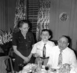 Richard with grandparents Gussie and Charles (father's side) at a Passover seder at their apartment  in the Bronx. (1951)