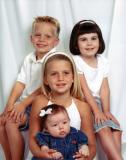 Grandchildren: Tyler and Hallie (top row) and Abbey holding Addy
