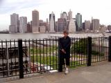 Judy on the Brooklyn Heights Promenade with part of the Manhattan skyline in the background