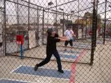 Richard at a baseball batting cage at Coney Island, Brooklyn, pretending to be 20 again. Seth is in the background.