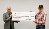 Jeff Parsons presenting BCHW President Bob Gish the big check