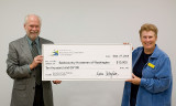 Jeff Parsons presenting BCHW Education Chair Jane Byram the big check