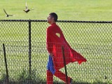 Superman returning from a mission in Central Park NYC USA