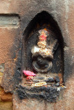 Carving of Kali and Offerings