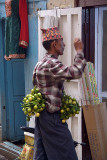 Man Selling Limes and Chillies for Protection