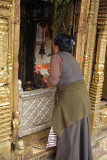 Lady in Tibetan Clothes Making Offering at Janabaha