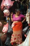 Female Shopkeeper in Doorway