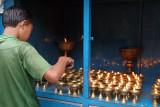 Boy Tending Butter Lamps Kathmandu