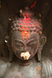 Annointed Buddha Statue with Offerings